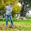 Girls-raking-fallen-autumn-leaves-in-garden-austockphoto-000013341.thumb